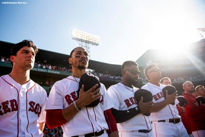 BOSTON, MA - SEPTEMBER 15: Andrew Benintendi #16, Mookie Betts #50, and Jackie Bradley Jr. #19 of the Boston Red Sox line up before a game against the New York Mets on September 15, 2018 at Fenway Park in Boston, Massachusetts. (Photo by Billie Weiss/Boston Red Sox/Getty Images) *** Local Caption *** Mookie Betts; Jackie Bradley Jr.; Andrew Benintendi