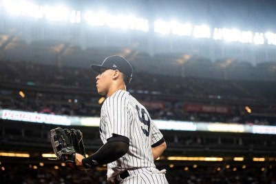 NEW YORK, NY - SEPTEMBER 18: Aaron Judge #99 of the New York Yankees runs into the dugout during the first inning of a game against the Boston Red Sox on September 18, 2018 at Yankee Stadium in the Bronx borough of New York City. (Photo by Billie Weiss/Boston Red Sox/Getty Images) *** Local Caption *** Aaron Judge