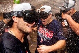 NEW YORK, NY - SEPTEMBER 20: Andrew Benintendi #16 and Brock Holt #12 of the Boston Red Sox celebrate in the clubhouse after clinching the American League East division following a victory against the New York Yankees on September 20, 2018 at Yankee Stadium in the Bronx borough of New York City. (Photo by Billie Weiss/Boston Red Sox/Getty Images) *** Local Caption *** Andrew Benintendi; Brock Holt
