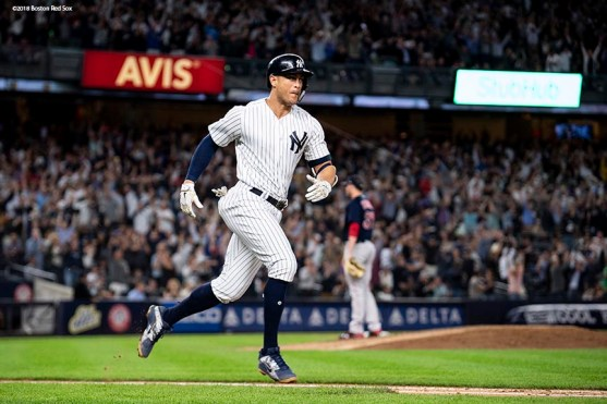 NEW YORK, NY - SEPTEMBER 20: Giancarlo Stanton #27 of the New York Yankees rounds the bases after hitting a grand slam during the fourth inning of a game against the Boston Red Sox on September 20, 2018 at Yankee Stadium in the Bronx borough of New York City. (Photo by Billie Weiss/Boston Red Sox/Getty Images) *** Local Caption *** Giancarlo Stanton