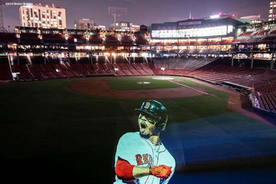 BOSTON, MA - OCTOBER 4: An image of Mookie Betts #50 of the Boston Red Sox is projected onto the field Fenway Park on October 4, 2018 in Boston, Massachusetts. (Photo by Billie Weiss/Boston Red Sox/Getty Images) *** Local Caption *** Mookie Betts