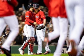 BOSTON, MA - OCTOBER 5: Craig Kimbrel #46 of the Boston Red Sox hugs Sandy Leon #3 after recording the final out in the ninth inning of game one of the American League Division Series against the New York Yankees on October 5, 2018 at Fenway Park in Boston, Massachusetts. (Photo by Billie Weiss/Boston Red Sox/Getty Images) *** Local Caption *** Craig Kimbrel; Sandy Leon