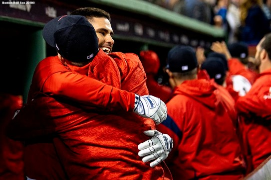 BOSTON, MA - OCTOBER 5: J.D. Martinez #28 of the Boston Red Sox hugs Brock Holt #12 after hitting a three run home run during the first inning of game one of the American League Division Series against the New York Yankees on October 5, 2018 at Fenway Park in Boston, Massachusetts. (Photo by Billie Weiss/Boston Red Sox/Getty Images) *** Local Caption *** J.D. Martinez; Brock Holt