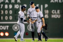 BOSTON, MA - OCTOBER 6: Aaron Judge #99, Brett Gardner #11, and Andrew McCutchen #26 of the New York Yankees celebrate a victory in game two of the American League Division Series against the Boston Red Sox on October 6, 2018 at Fenway Park in Boston, Massachusetts. (Photo by Billie Weiss/Boston Red Sox/Getty Images) *** Local Caption *** Aaron Judge; Andrew McCutchen; Brett Gardner