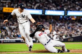 NEW YORK, NY - OCTOBER 9: Jackie Bradley Jr. #19 of the Boston Red Sox slides as he is tagged out by Luke Voit #45 of the New York Yankees during the third inning of game four of the American League Division Series on October 9, 2018 at Yankee Stadium in the Bronx borough of New York City. (Photo by Billie Weiss/Boston Red Sox/Getty Images) *** Local Caption *** Jackie Bradley Jr.; Luke Voit