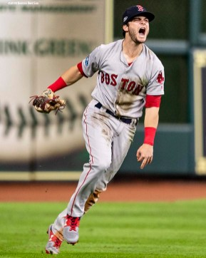 HOUSTON, TX - OCTOBER 17: Andrew Benintendi #16 of the Boston Red Sox reacts after catching the final out of the game during the ninth inning of game four of the American League Championship Series against the Houston Astros on October 17, 2018 at Minute Maid Park in Houston, Texas. (Photo by Billie Weiss/Boston Red Sox/Getty Images) *** Local Caption *** Andrew Benintendi