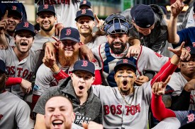 HOUSTON, TX - OCTOBER 18: Mookie Betts #50, Andrew Benintendi #16, Craig Kimbrel #46, Brock Holt #12, Sandy Leon #3 and Mookie Betts #50 of the Boston Red Sox celebrate as they pose for a team photograph after clinching the American League Championship Series in game five against the Houston Astros on October 18, 2018 at Minute Maid Park in Houston, Texas. (Photo by Billie Weiss/Boston Red Sox/Getty Images) *** Local Caption *** Andrew Benintendi; Mookie Betts; Sandy Leon; Craig Kimbre; Andrew Benintendi; Brock Holt