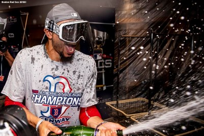 HOUSTON, TX - OCTOBER 18: Mookie Betts #50 of the Boston Red Sox celebrates with champagne in the clubhouse after clinching the American League Championship Series in game five against the Houston Astros on October 18, 2018 at Minute Maid Park in Houston, Texas. (Photo by Billie Weiss/Boston Red Sox/Getty Images) *** Local Caption ***Mookie Betts