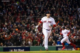 BOSTON, MA - OCTOBER 24: Mookie Betts #50 scores as J.D. Martinez #28 of the Boston Red Sox runs up the line after hitting an RBI single during the fifth inning of game two of the 2018 World Series against the Los Angeles Dodgers on October 23, 2018 at Fenway Park in Boston, Massachusetts. (Photo by Billie Weiss/Boston Red Sox/Getty Images) *** Local Caption *** Mookie Betts; J.D. Martinez