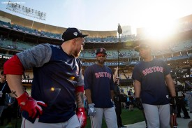 LOS ANGELES, CA - OCTOBER 26: Christian Vazquez #7, Eduardo Nunez #36, and Rafael Devers #11 of the Boston Red Sox talk during batting practice before game three of the 2018 World Series against the Los Angeles Dodgers on October 26, 2018 at Dodger Stadium in Los Angeles, California. (Photo by Billie Weiss/Boston Red Sox/Getty Images) *** Local Caption *** Rafael Devers; Christian Vazquez; Eduardo Nunez