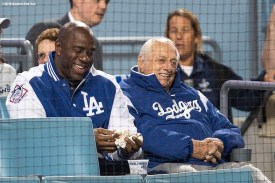 LOS ANGELES, CA - OCTOBER 27: Magic Johnson and Tommy Lasorda of theLos Angeles Dodgers look on during game three of the 2018 World Series against the Boston Red Sox on October 27, 2018 at Dodger Stadium in Los Angeles, California. (Photo by Billie Weiss/Boston Red Sox/Getty Images) *** Local Caption *** Tommy Lasorda; Magic Johnson