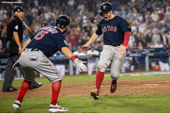LOS ANGELES, CA - OCTOBER 27: Brock Holt #12 of the Boston Red Sox reacts with Ian Kinsler #5 as he scores during the ninth inning of game four of the 2018 World Series against the Los Angeles Dodgers on October 27, 2018 at Dodger Stadium in Los Angeles, California. (Photo by Billie Weiss/Boston Red Sox/Getty Images) *** Local Caption *** Brock Holt; Ian Kinsler