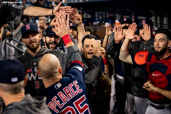 LOS ANGELES, CA - OCTOBER 27: Steve Pearce #25 of the Boston Red Sox high fives teammates afters coring during the ninth inning of game four of the 2018 World Series against the Los Angeles Dodgers on October 27, 2018 at Dodger Stadium in Los Angeles, California. (Photo by Billie Weiss/Boston Red Sox/Getty Images) *** Local Caption *** Steve Pearce