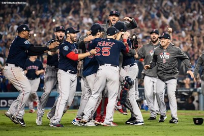 LOS ANGELES, CA - OCTOBER 28: Members of the Boston Red Sox react after the final out was recorded to win the 2018 World Series in game five against the Los Angeles Dodgers on October 28, 2018 at Dodger Stadium in Los Angeles, California. (Photo by Billie Weiss/Boston Red Sox/Getty Images) *** Local Caption *** Chris Sale; Christian Vazquez; David Price