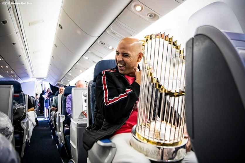 LOS ANGELES, CA - OCTOBER 29: Manager Alex Cora of the Boston Red Sox reacts as he holds the World Series trophy as the team travels to Boston after winning the 2018 World Series against the Los Angeles Dodgers on October 29, 2018 in Los Angeles, California. (Photo by Billie Weiss/Boston Red Sox/Getty Images) *** Local Caption *** Alex Cora