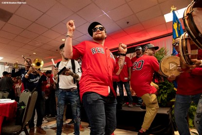 CAGUAS, PUERTO RICO - NOVEMBER 3: Christian Vazquez #7 of the Boston Red Sox dances during a trip from Boston, Massachusetts to Caguas, Puerto Rico on November 3, 2018 after the Boston Red Sox 2018 World Series victory. (Photo by Billie Weiss/Boston Red Sox/Getty Images) *** Local Caption *** Christian Vazquez