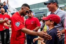 CAGUAS, PUERTO RICO - NOVEMBER 3: Eduardo Nunez #36 of the Boston Red Sox greets a young fan during a trip from Boston, Massachusetts to Caguas, Puerto Rico on November 3, 2018 after the Boston Red Sox 2018 World Series victory. (Photo by Billie Weiss/Boston Red Sox/Getty Images) *** Local Caption *** Eduardo Nunez