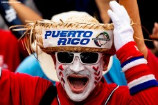 CAGUAS, PUERTO RICO - NOVEMBER 3: A fan cheers during a World Series parade during a Boston Red Sox trip from Boston, Massachusetts to Caguas, Puerto Rico on November 3, 2018 after the Boston Red Sox 2018 World Series victory. (Photo by Billie Weiss/Boston Red Sox/Getty Images) *** Local Caption ***