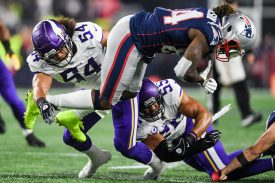 FOXBOROUGH, MA - DECEMBER 02: Cordarrelle Patterson #84 of the New England Patriots is tackled by Eric Kendricks #54 and Anthony Barr #55 of the Minnesota Vikings during the first half at Gillette Stadium on December 2, 2018 in Foxborough, Massachusetts. (Photo by Billie Weiss/Getty Images)