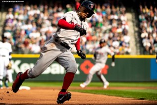 SEATTLE, WA - MARCH 28: Mookie Betts #50 of the Boston Red Sox rounds third base as he scores during the first inning of the 2019 Opening day game against the Seattle Mariners at T-Mobile Park in Seattle, Washington on March 28, 2019. (Photo by Billie Weiss/Boston Red Sox/Getty Images) *** Local Caption *** Mookie Betts
