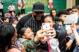 April 4, 2019 , Boston, MA: Former Boston Red Sox designated hitter David Ortiz poses for a selfie photograph as he gives away hats to students during a visit to the Sarah Greenwood School in Dorchester, Massachusetts Thursday, April 4, 2019. (Photo by Billie Weiss/Boston Red Sox)