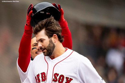 BOSTON, MA - APRIL 9: Mitch Moreland #18 of the Boston Red Sox reacts with Mookie Betts #50 after hitting a solo home run during the second inning of the Opening Day game against the Toronto Blue Jays on April 9, 2019 at Fenway Park in Boston, Massachusetts. (Photo by Billie Weiss/Boston Red Sox/Getty Images) *** Local Caption *** Mitch Moreland; Mookie Betts