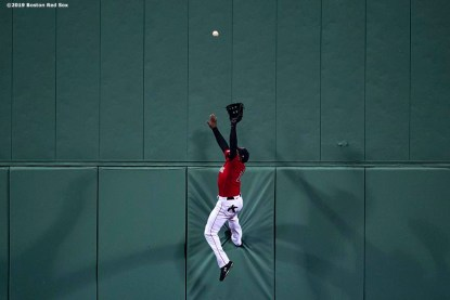 BOSTON, MA - APRIL 12: Jackie Bradley Jr. #19 of the Boston Red Sox makes a leaping catch against the wall during the ninth inning of a game against the Baltimore Orioles on April 12, 2019 at Fenway Park in Boston, Massachusetts. (Photo by Billie Weiss/Boston Red Sox/Getty Images) *** Local Caption *** Jackie Bradley Jr.