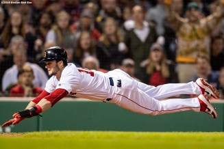 BOSTON, MA - APRIL 29: Andrew Benintendi #16 of the Boston Red Sox slides as he scores on a sacrifice fly during the eighth inning of a game against the Oakland Athletics on April 29, 2019 at Fenway Park in Boston, Massachusetts. (Photo by Billie Weiss/Boston Red Sox/Getty Images) *** Local Caption *** Andrew Benintendi