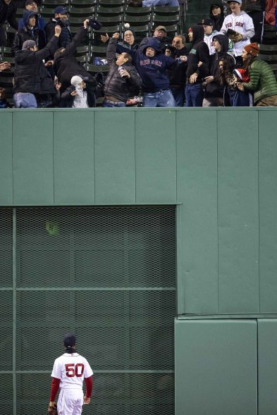 BOSTON, MA - MAY 14: Mookie Betts #50 of the Boston Red Sox watches as a go ahead home run ball hit by Charlie Blackmon #19 of the Colorado Rockies goes into the stands during the eighth inning of a game on May 14, 2019 at Fenway Park in Boston, Massachusetts. (Photo by Billie Weiss/Boston Red Sox/Getty Images) *** Local Caption *** Mookie Betts
