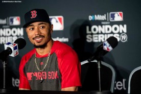 LONDON, ENGLAND - JUNE 28 : Mookie Betts #50 of the Boston Red Sox addresses the media in a press conference during a team workout ahead of the 2019 Major League Baseball London Series on June 28, 2019 at West Ham London Stadium in London, England. (Photo by Billie Weiss/Boston Red Sox/Getty Images) *** Local Caption *** Mookie Betts