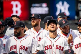 LONDON, ENGLAND - JUNE 28 : Michael Chavis #23 of the Boston Red Sox reacts as the team photo is taken during a team workout ahead of the 2019 Major League Baseball London Series on June 28, 2019 at West Ham London Stadium in London, England. (Photo by Billie Weiss/Boston Red Sox/Getty Images) *** Local Caption *** Michael Chavis