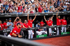 LONDON, ENGLAND - JUNE 30: Players in the dugout react as Michael Chavis #23 of the Boston Red Sox catches a foul ball during the sixth inning of game two of the 2019 Major League Baseball London Series against the New York Yankees on June 30, 2019 at West Ham London Stadium in London, England. (Photo by Billie Weiss/Boston Red Sox/Getty Images) *** Local Caption *** Michael Chavis