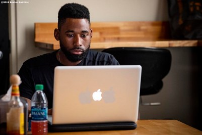 BOSTON, MA - JULY 16: Jackie Bradley Jr. #19 of the Boston Red Sox works on a laptop before a game against the Toronto Blue Jays on July 16, 2019 at Fenway Park in Boston, Massachusetts. (Photo by Billie Weiss/Boston Red Sox/Getty Images) *** Local Caption *** Jackie Bradley Jr.