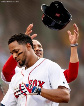 BOSTON, MA - JULY 16: Xander Bogaerts #2 of the Boston Red Sox has his helmet removed by Mookie Betts #50 after hitting a solo home run during the first inning of a game against the Toronto Blue Jays on July 16, 2019 at Fenway Park in Boston, Massachusetts. (Photo by Billie Weiss/Boston Red Sox/Getty Images) *** Local Caption *** Xander Bogaerts; Mookie Betts