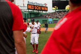 BOSTON, MA - JULY 18: Mookie Betts #50 of the Boston Red Sox high fives teammates after a victory against the Toronto Blue Jays on July 18, 2019 at Fenway Park in Boston, Massachusetts. (Photo by Billie Weiss/Boston Red Sox/Getty Images) *** Local Caption *** Mookie Betts