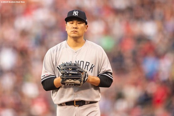 BOSTON, MA - JULY 25: Masahiro Tanaka #19 of the New York Yankees reacts during the first inning of a game against the Boston Red Sox on July 25, 2019 at Fenway Park in Boston, Massachusetts. (Photo by Billie Weiss/Boston Red Sox/Getty Images) *** Local Caption *** Masahiro Tanaka