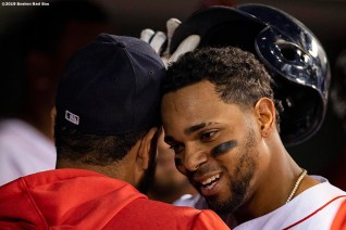 BOSTON, MA - JULY 25: Xander Bogaerts #2 of the Boston Red Sox reacts with Eduardo Rodriguez #57 after hitting a solo home run during the ninth inning of a game against the New York Yankees on July 25, 2019 at Fenway Park in Boston, Massachusetts. It was his second home run of the game. (Photo by Billie Weiss/Boston Red Sox/Getty Images) *** Local Caption *** Xander Bogaerts; Eduardo Rodriguez