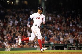 BOSTON, MA - JULY 25: Xander Bogaerts #2 of the Boston Red Sox reacts after hitting a solo home run during the ninth inning of a game against the New York Yankees on July 25, 2019 at Fenway Park in Boston, Massachusetts. It was his second home run of the game. (Photo by Billie Weiss/Boston Red Sox/Getty Images) *** Local Caption *** Xander Bogaerts