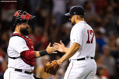 BOSTON, MA - JULY 25: Nathan Eovaldi #17 of the Boston Red Sox high fives Sandy Leon #3 after a victory against the New York Yankees on July 25, 2019 at Fenway Park in Boston, Massachusetts. (Photo by Billie Weiss/Boston Red Sox/Getty Images) *** Local Caption *** Nathan Eovaldi; Sandy Leon