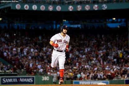 BOSTON, MA - JULY 28: Andrew Benintendi #16 of the Boston Red Sox rounds the bases after hitting a two run home run during the fourth inning of a game against the New York Yankees on July 28, 2019 at Fenway Park in Boston, Massachusetts. (Photo by Billie Weiss/Boston Red Sox/Getty Images) *** Local Caption *** Andrew Benintendi