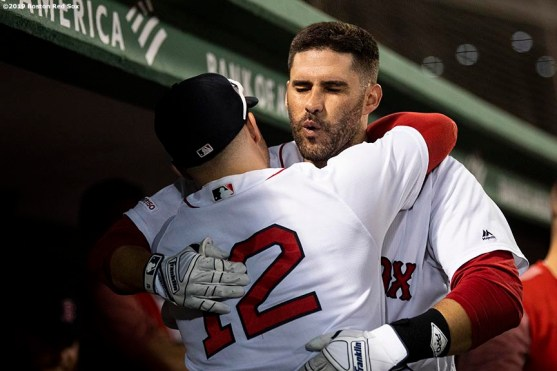 BOSTON, MA - JULY 31: J.D. Martinez #28 of the Boston Red Sox hugs Brock Holt #12 after hitting a solo home run during the fourth inning of a game against the Tampa Bay Rays on July 31, 2019 at Fenway Park in Boston, Massachusetts. (Photo by Billie Weiss/Boston Red Sox/Getty Images) *** Local Caption *** J.D. Martinez; Brock Holt