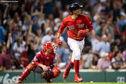 BOSTON, MA - AUGUST 9: Mookie Betts #50 of the Boston Red Sox reacts after hitting a go ahead two run home run during the fifth inning of a game against the Los Angeles Angels of Anaheim on August 9, 2019 at Fenway Park in Boston, Massachusetts. (Photo by Billie Weiss/Boston Red Sox/Getty Images) *** Local Caption *** Mookie Betts