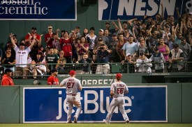 BOSTON, MA - AUGUST 9: Mike Trout #27 and Kole Calhoun #56 of the Los Angeles Angels of Anaheim react as fans cheer for a home run hit by J.D. Martinez #28 of the Boston Red Sox during the seventh inning of a game on August 9, 2019 at Fenway Park in Boston, Massachusetts. (Photo by Billie Weiss/Boston Red Sox/Getty Images) *** Local Caption *** Mike Trout; Kole Calhoun