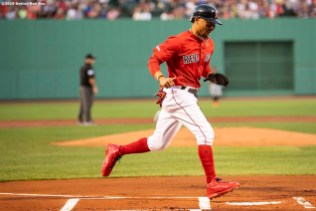BOSTON, MA - AUGUST 16: Mookie Betts #50 of the Boston Red Sox scores during the first inning of a game against the Baltimore Orioles on August 16, 2019 at Fenway Park in Boston, Massachusetts. (Photo by Billie Weiss/Boston Red Sox/Getty Images) *** Local Caption *** Mookie Betts