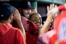 BOSTON, MA - AUGUST 16: Mookie Betts #50 of the Boston Red Sox reacts with teammates after hitting a solo home run during the eighth inning of a game against the Baltimore Orioles on August 16, 2019 at Fenway Park in Boston, Massachusetts. (Photo by Billie Weiss/Boston Red Sox/Getty Images) *** Local Caption *** Mookie Betts