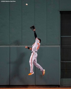BOSTON, MA - AUGUST 17: Stevie Wilkerson #12 of the Baltimore Orioles makes a leaping catch to rob Mitch Moreland #18 of the Boston Red Sox during the fourth inning of a game on August 17, 2019 at Fenway Park in Boston, Massachusetts. (Photo by Billie Weiss/Boston Red Sox/Getty Images) *** Local Caption *** Stevie Wilkerson