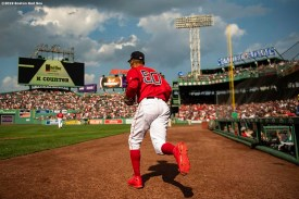 BOSTON, MA - AUGUST 18: Mookie Betts #50 of the Boston Red Sox runs onto the field during the eighth inning of a game against the Baltimore Orioles on August 18, 2019 at Fenway Park in Boston, Massachusetts. (Photo by Billie Weiss/Boston Red Sox/Getty Images) *** Local Caption *** Mookie Betts
