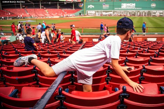 BOSTON, MA - AUGUST 22: A young fan finds a seat before the continuation of a game between Boston Red Sox and the Kansas City Royals on August 22, 2019 at Fenway Park in Boston, Massachusetts. The original game was suspended due to weather on August 7 in the top of the 10th inning with a tied score of 4-4. (Photo by Billie Weiss/Boston Red Sox/Getty Images) *** Local Caption ***