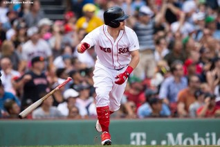 BOSTON, MA - AUGUST 22: Brock Holt #12 of the Boston Red Sox hits a game winning walk-off RBI single during the tenth inning of a game against the Kansas City Royals on August 22, 2019 at Fenway Park in Boston, Massachusetts. The game is the completion of the game that was suspended due to weather on August 7 in the top of the 10th inning with a tied score of 4-4. (Photo by Billie Weiss/Boston Red Sox/Getty Images) *** Local Caption *** Brock Holt