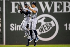 BOSTON, MA - SEPTEMBER 8: Cameron Maybin #18, Aaron Judge #99, and Brett Gardner #11 of the New York Yankees celebrate a victory against the Boston Red Sox on September 8, 2019 at Fenway Park in Boston, Massachusetts. (Photo by Billie Weiss/Boston Red Sox/Getty Images) *** Local Caption *** Cameron Maybin; Aaron Judge; Brett Gardner